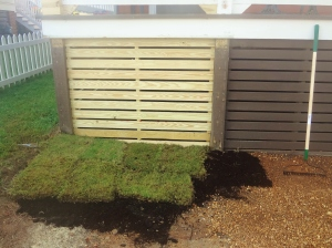 The never-ending battle between pebbles and sod!  Sod is winning. :)