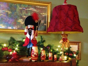 Mr. Nutcracker stands guard over the nesting Santas.