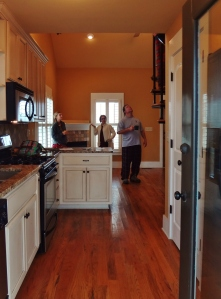 Hannah and Uncle Dave inspect the digs. Directly opposite the sink is a closet containing a pantry and stacked washer/dryer.